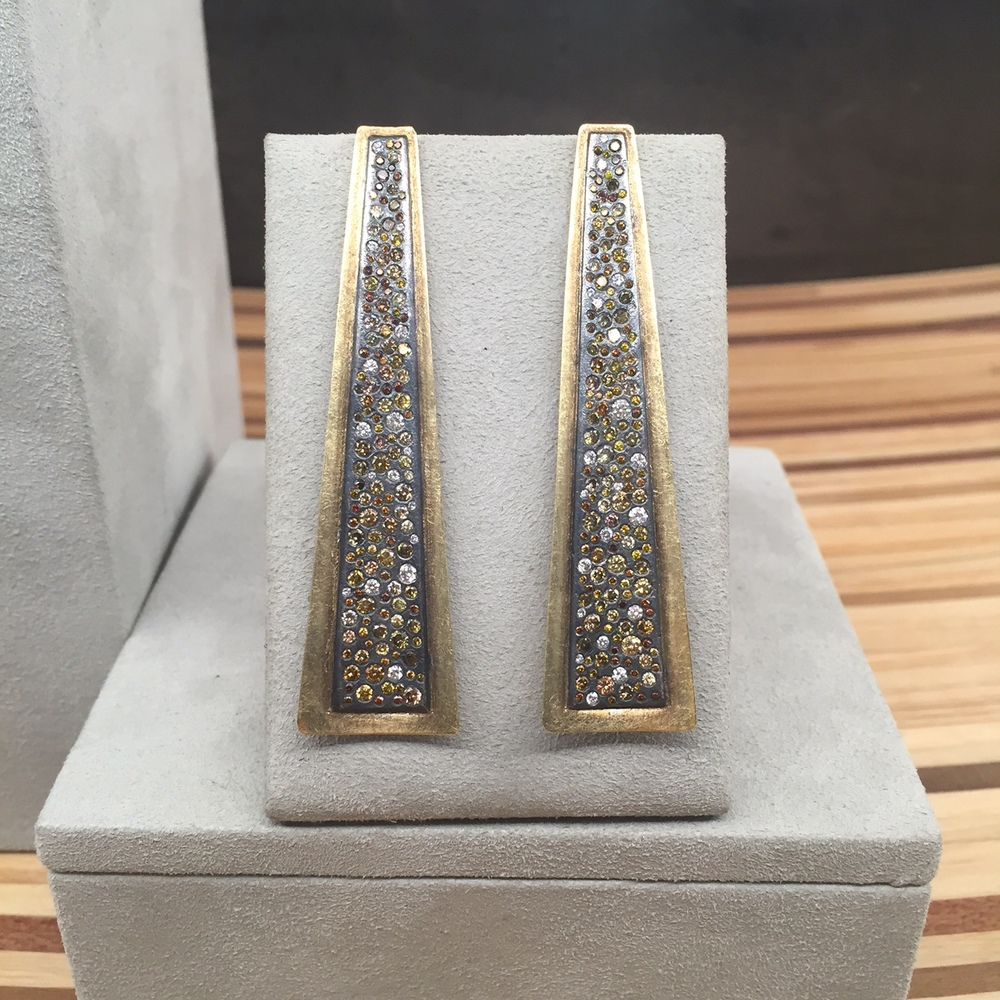 A closeup of the earrings we want to wear to every formal event for the rest of our lives.