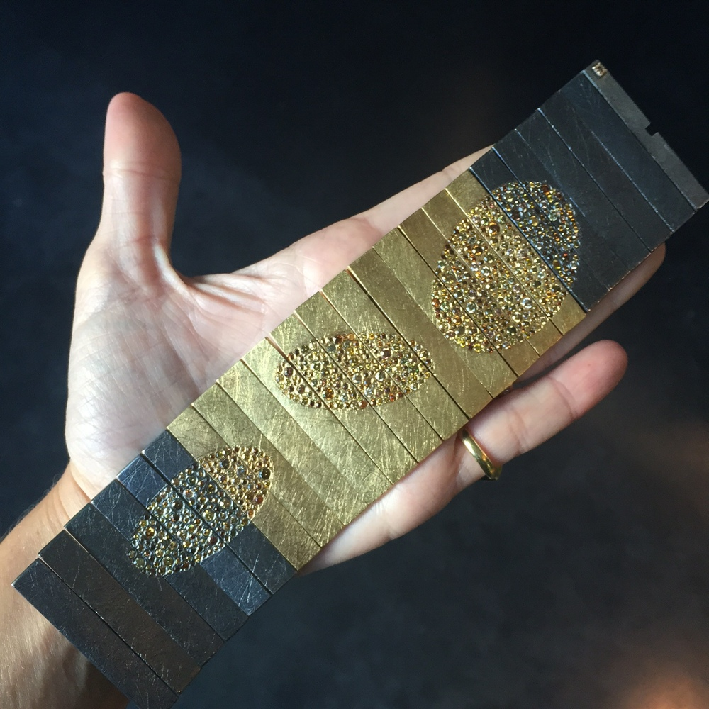 Another epic two-toned piece, this time a flexible cuff dotted with diamonds.