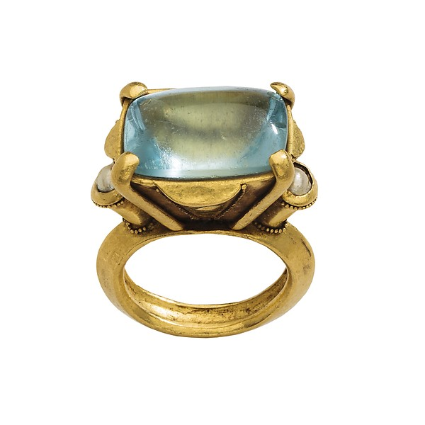 A cushion-cut aquamarine ring from the 12-13th Century featuring a bezel setting, prongs and granulation.