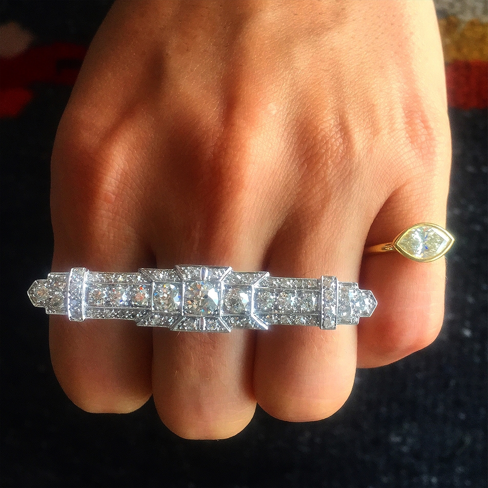 This impressive conversion was a vintage pin, transformed into a massive knuckle ring. Instant update.