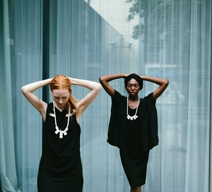 Look book shot from Women Made, featuring necklaces inspired by Jean-Michel Basquiat's 'Man Made' Project.