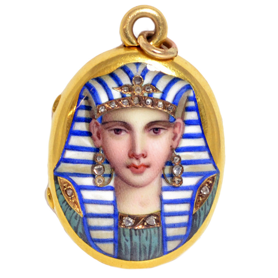 THIS BITCH IS FIERCE. An Egyptian Revival pendant, decorated with an enamel and rose diamond embellished figure's face. English, circa 1880, available at  Sandra Cronin via 1stdibs.com .