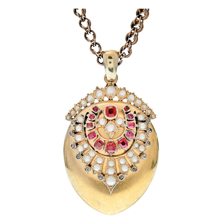 We feel like this locket is wearing a tiara, and we are on board. 18K gold ruby, diamond and pearl locket c.1890 available from  Fourtane via 1stdibs.com .