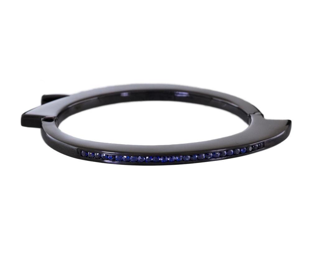Lynn Ban  sapphire handcuff bracelet, $2,200,  available at Twist .