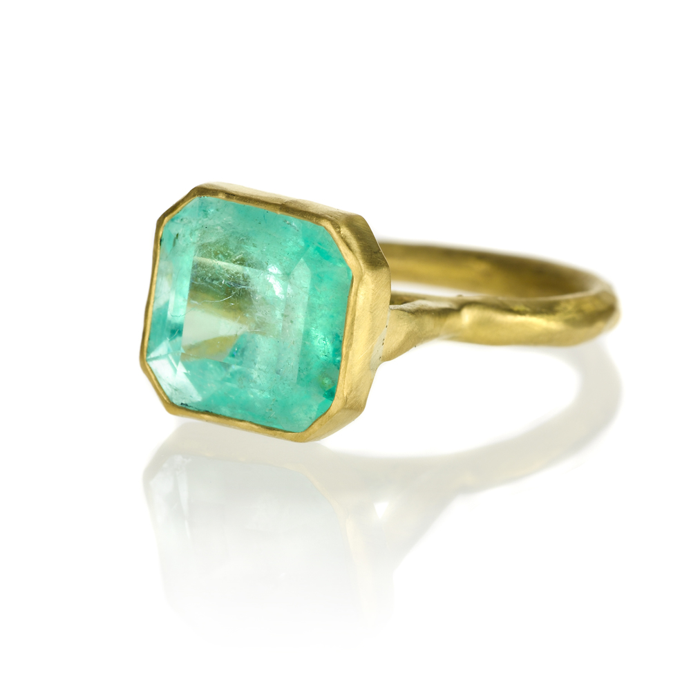 Give us this ring in 22k gold with an 8.25 ct. emerald, $6,700. Just give it to us.