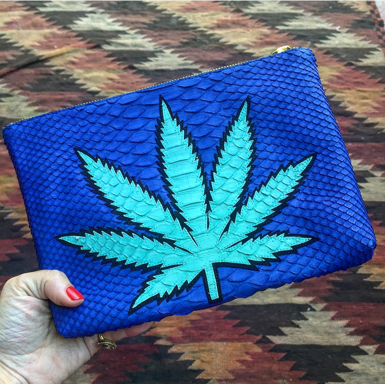 A snakeskin Sweet Leaf clutch.