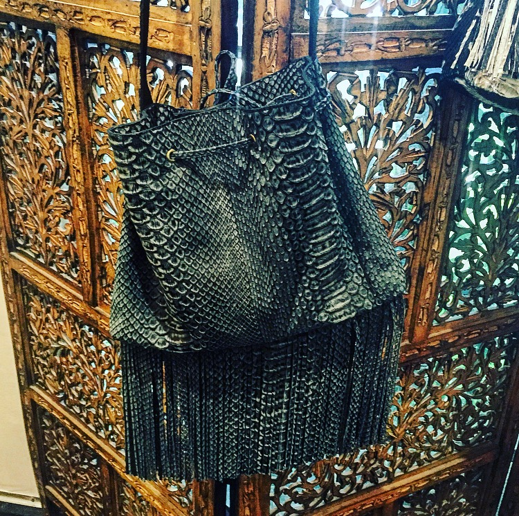 The snakeskin fringe bag Randi wanted to put on layaway. There is no layaway. :(