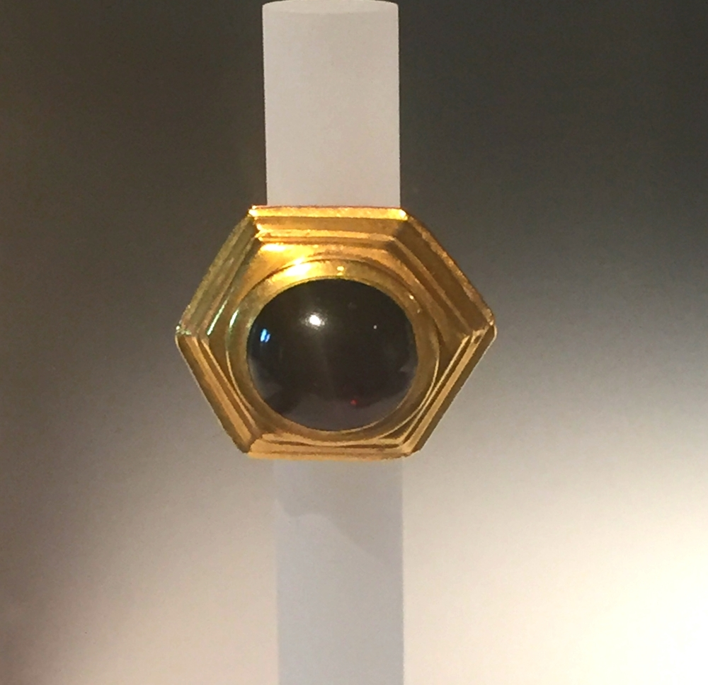Sapphire cabochon with an amazing hexagon bezel in 22K gold.