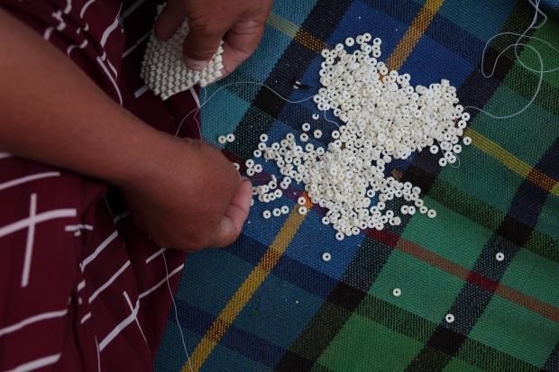 Hand-cut ostrich shell beads.
