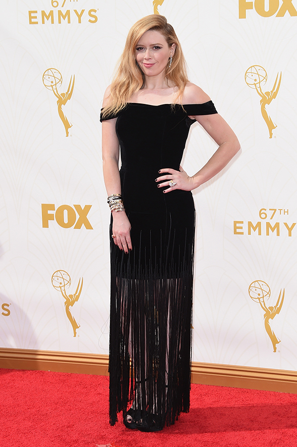 Natasha Lyonne in a magical fringe dress and a major bangle stack and statement ring.