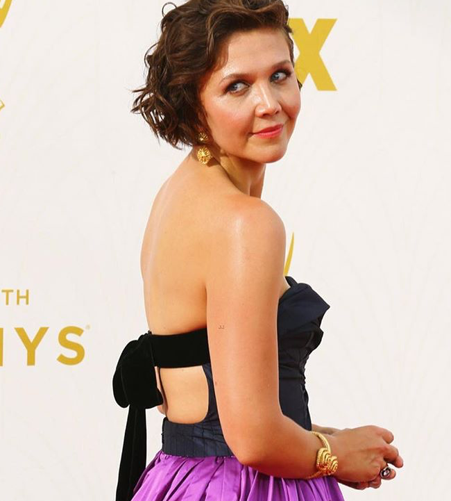 Fred Leighton cuff and earrings on Maggie are our favorites of the night.
