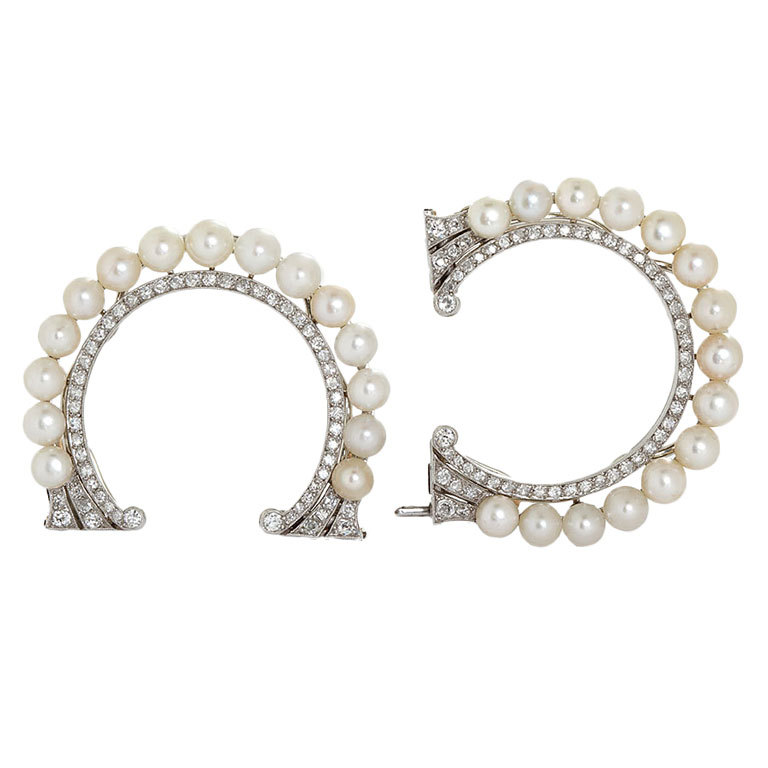 Ooh la la to these Parisian  Art Deco saltwater pearl and diamond clip brooches . We would fasten them to grosgrain and make two matching cuffs.