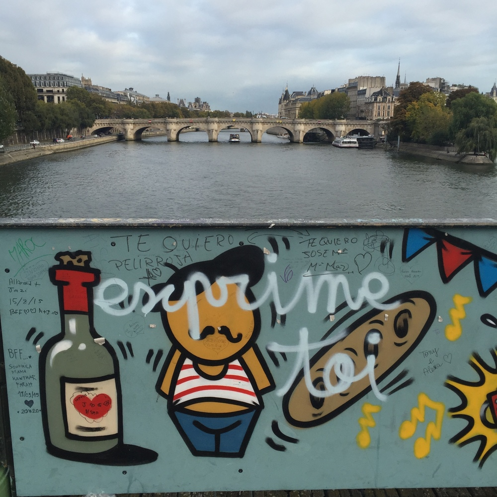 We look like this caricature on Pont des Arts. SO fat. So happy. We miss bread.