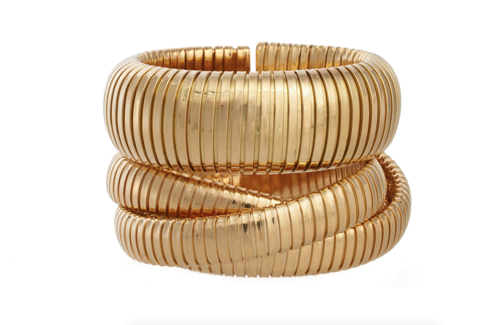 Domed cuff and rolling bracelet in 18k yellow gold.