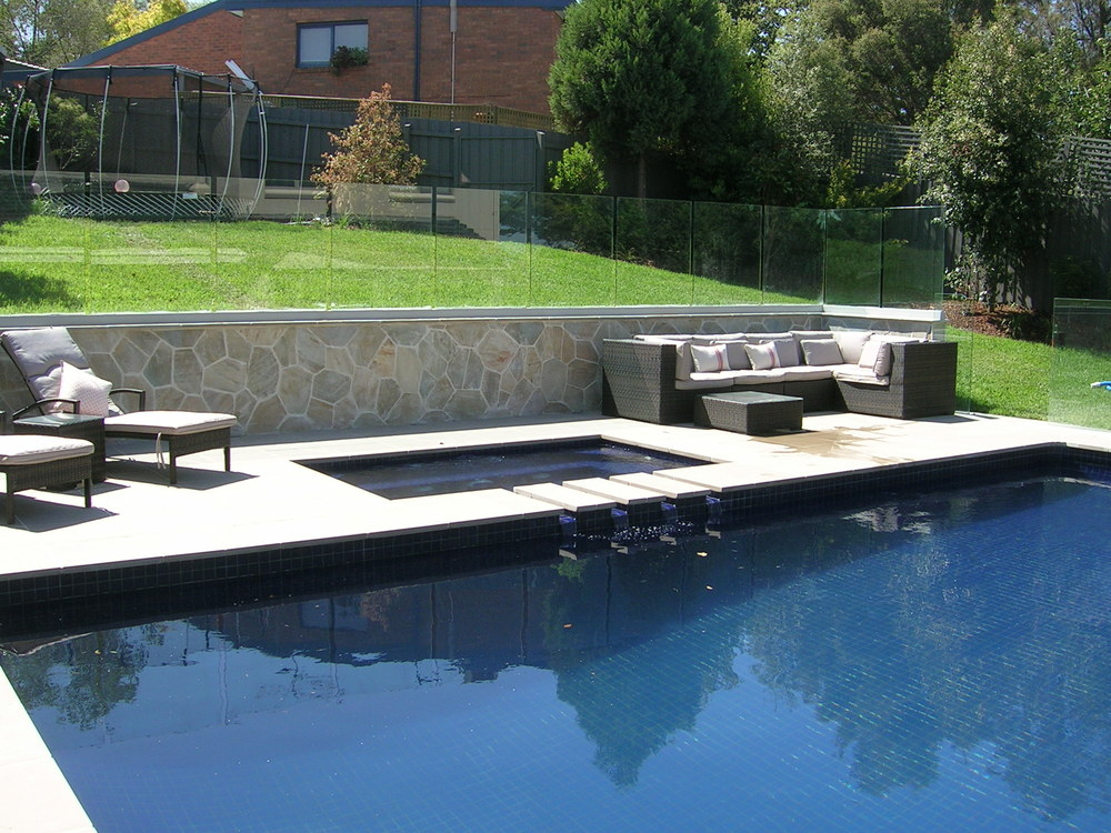An expanded lounging area and new spa tied in to the renovated pool gives the whole area a fresh new look - and a lawn to play on doubles the use.