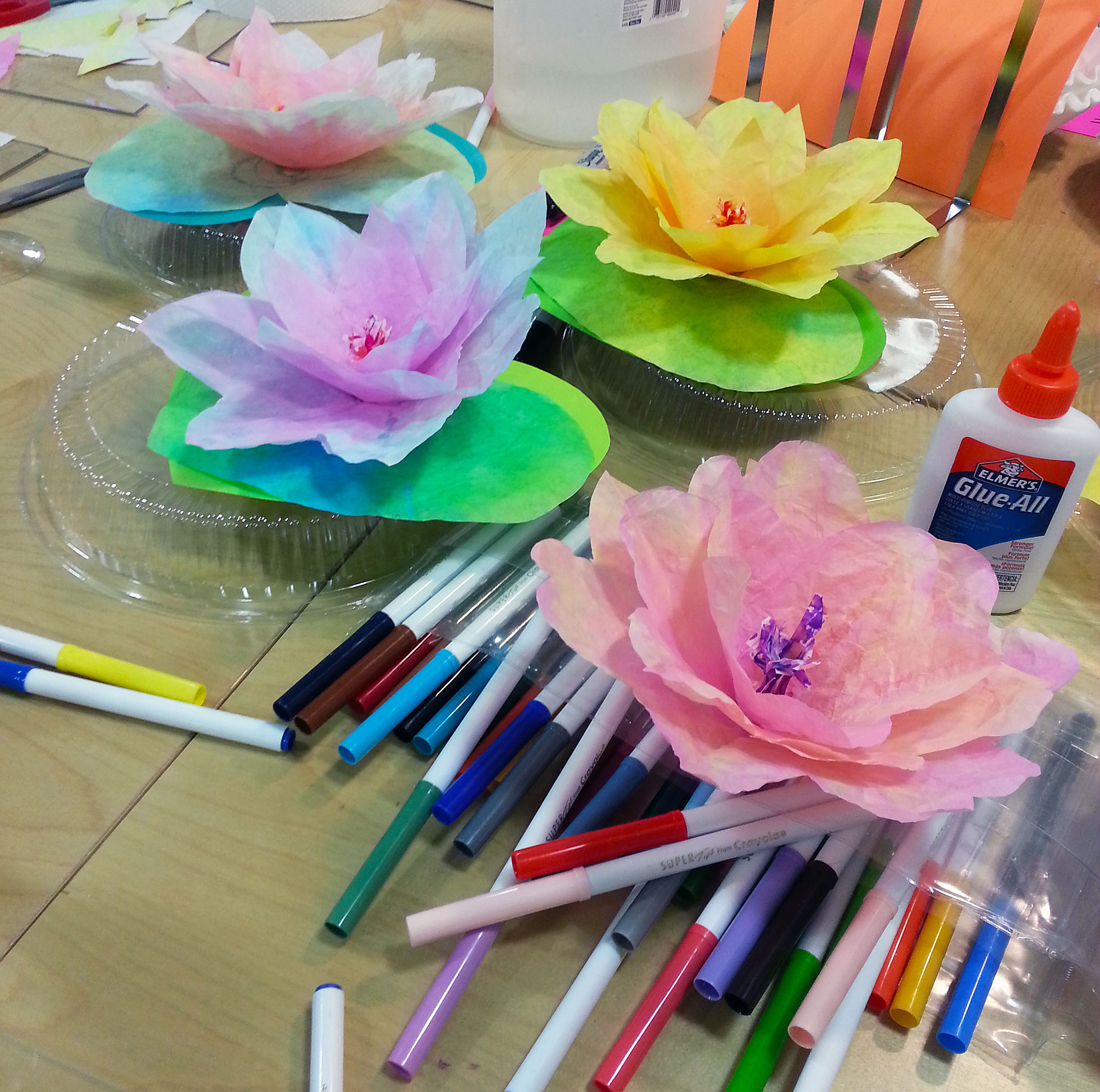Coffee filters make great lilies. The view from the paper-lily station during the Valentine's Mix & Make on Thursday. (Emi Kolawole)