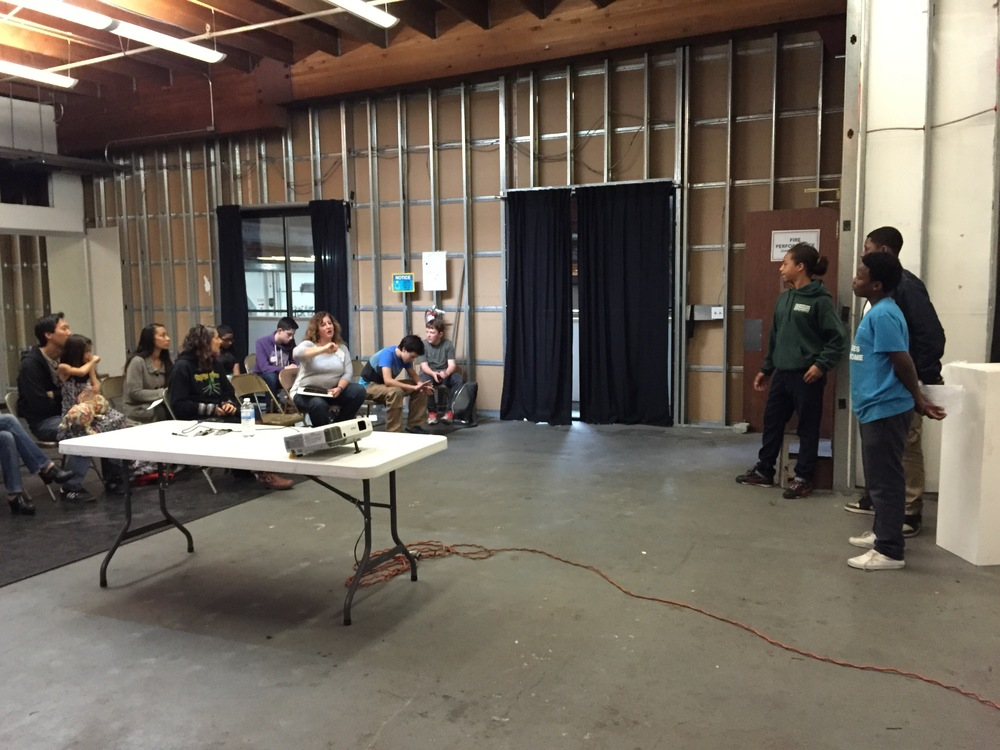 Students present their skit to assembled guests at Design School X in Oakland. (Emi Kolawole)