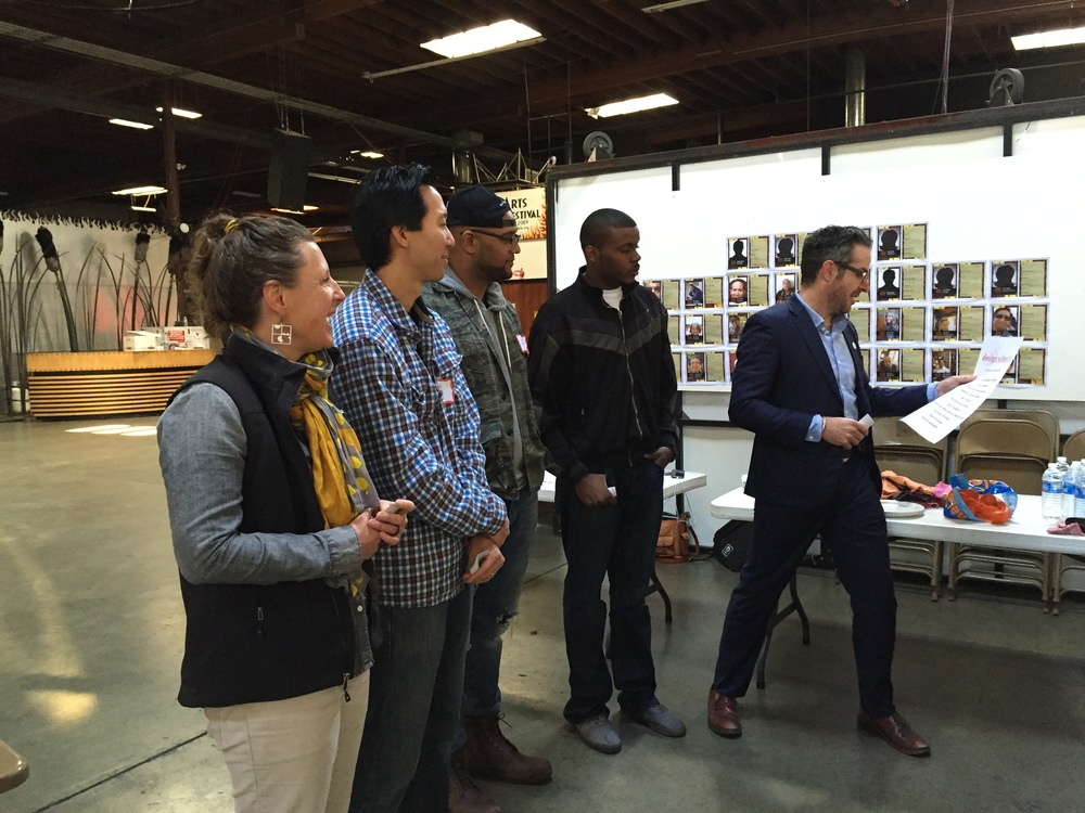 David introduces the prototypes to the students. He is joined by from (right to left), Michael Tubbs, Jason Mayden, Sam Yen and K12 Lab Network Director Susie Wise. (Emi Kolawole)