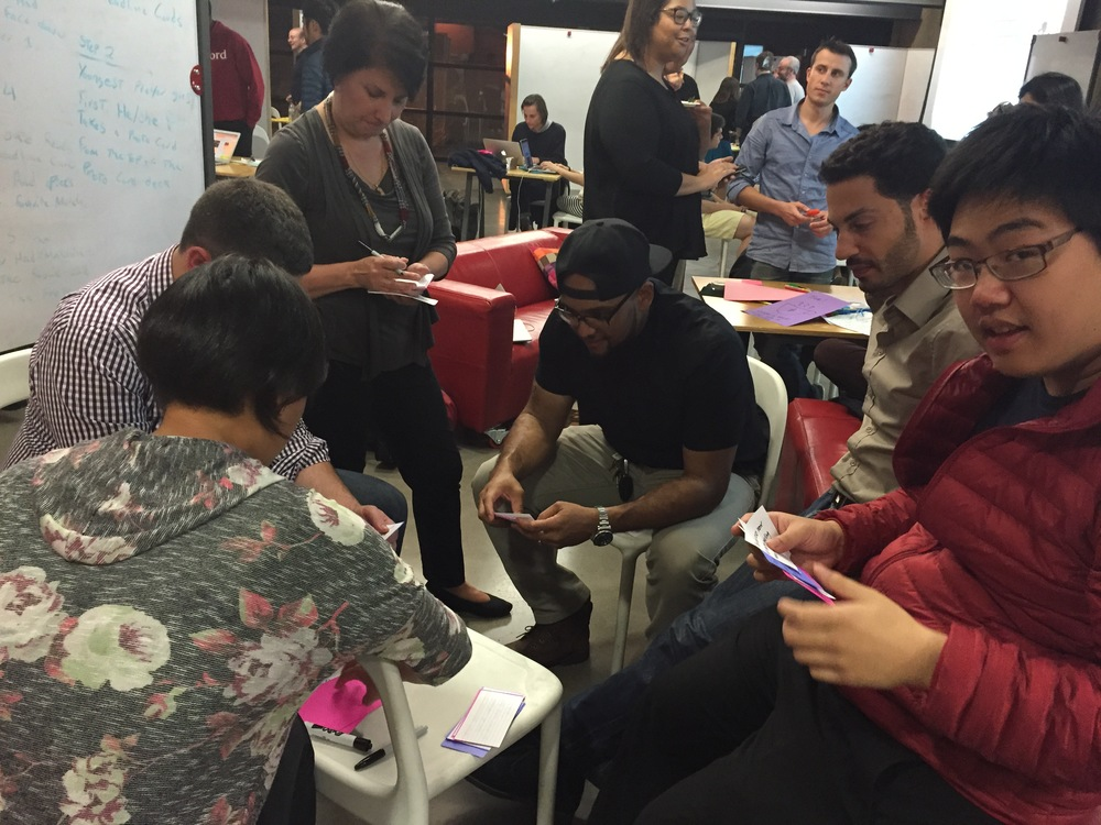 Students test their prototypes with d.school fellow, designer and Stanford Sloan Fellow alum Jason Mayden (center). (Emi Kolawole)