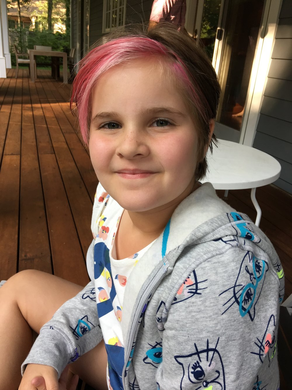 Despite my warnings of fading, Bean #2 went swimming a week after her hair was dyed. Here's the result of about 5 hours in a pool. -