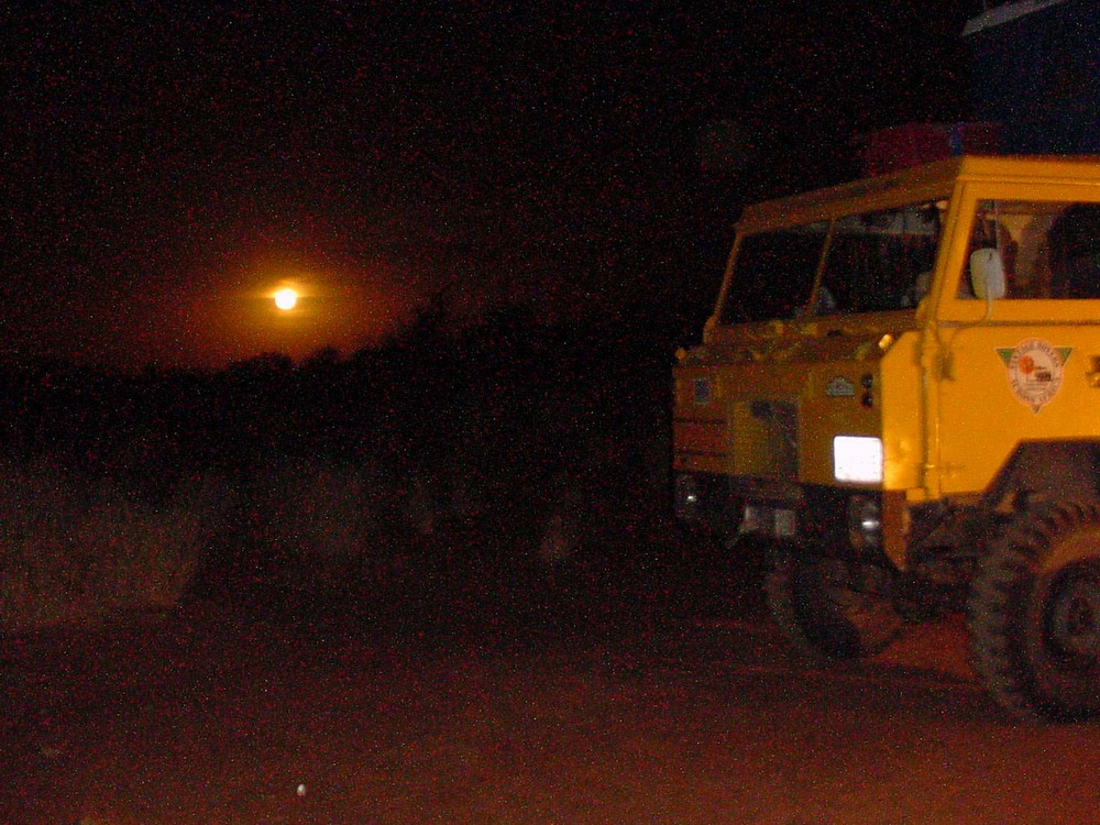 The moon rises over our Land Rover Expedition vehicle