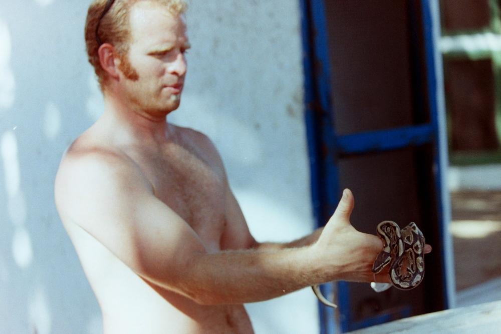 Shane Ballensky handles a snake