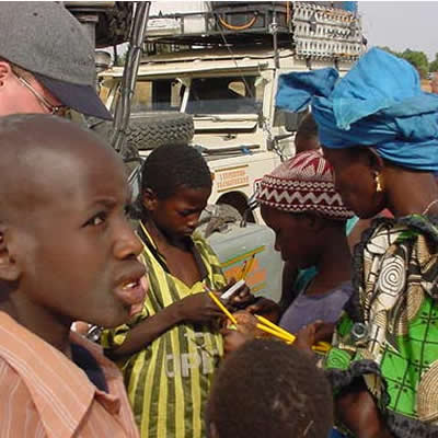 February 25, 2001Central Senegal - Truck repairs as crowds watch.