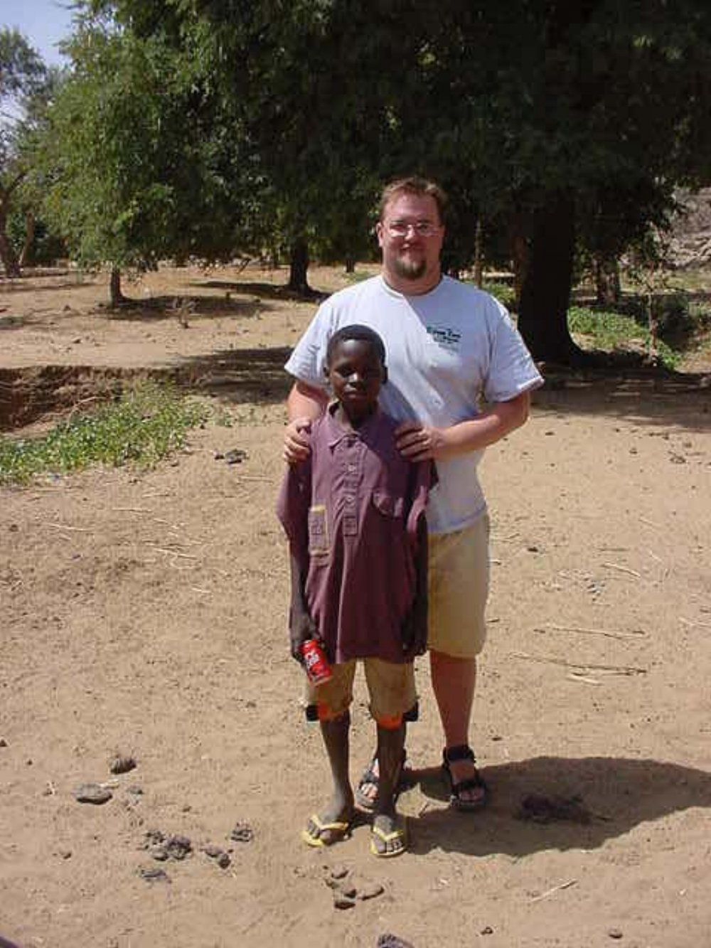 Paul Shumway & a local Dogon child
