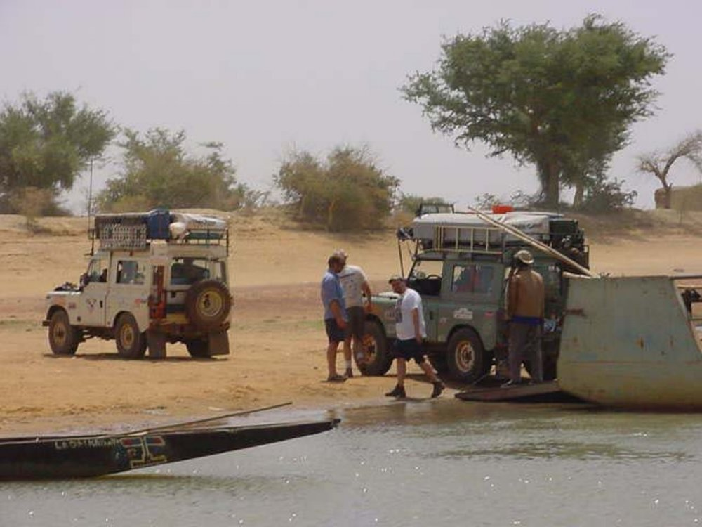 The Land Rovers unload from the Djenne Ferry