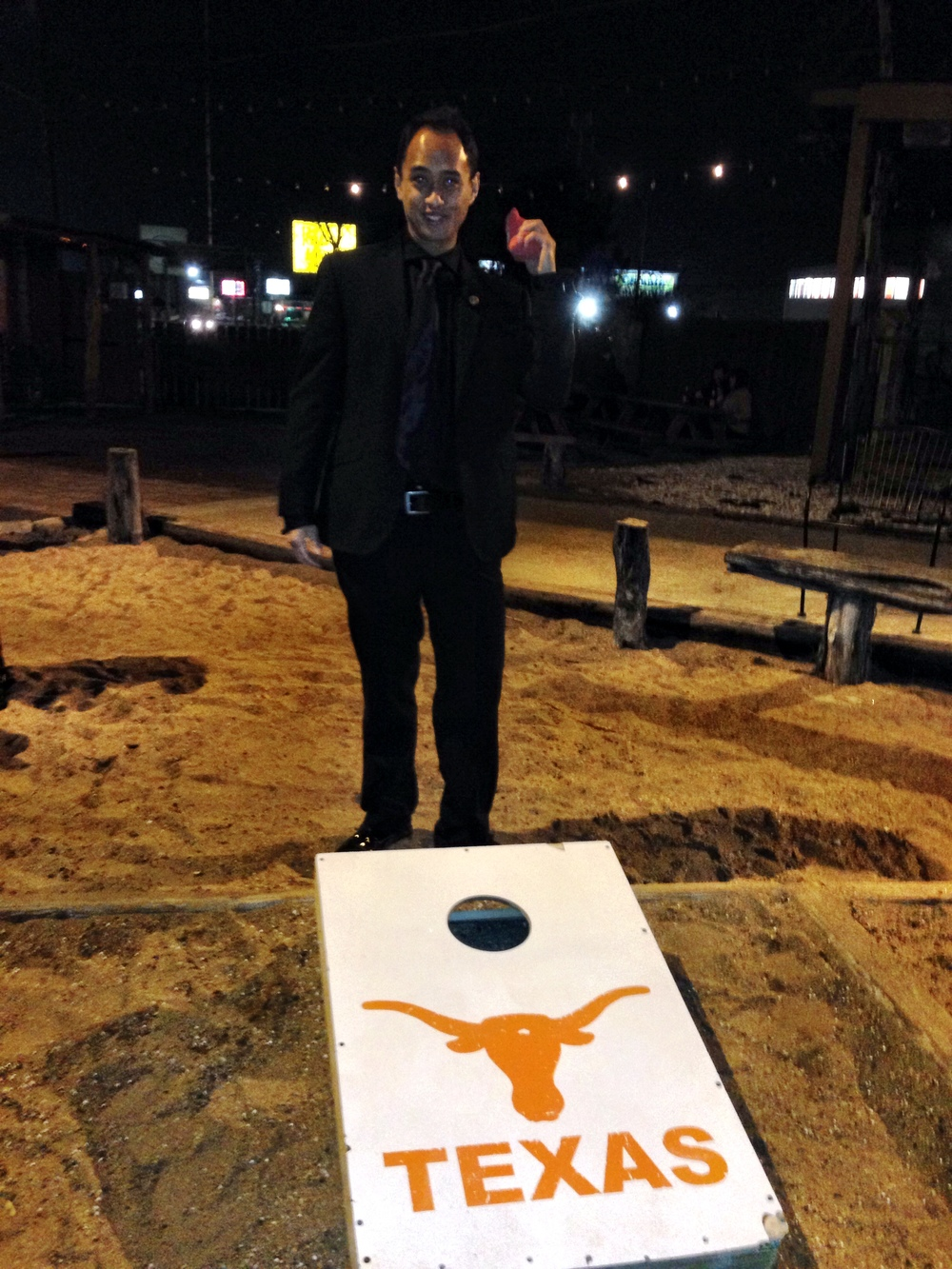 Suited up to play corn hole! Only in Austin...