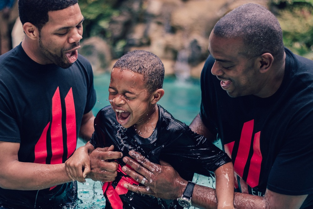 Father baptizes his son at post Easter (2015) service at Engage Church, in Tallahassee, Florida.  ©Samuel Febres