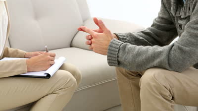 stock-footage-young-man-talking-with-his-therapist-at-therapy-session.jpg