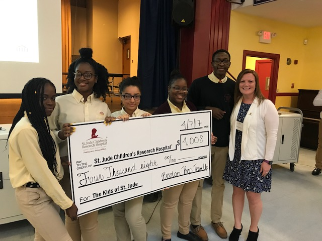 A representative from St. Jude's visited a Boston Prep community meeting to accept the donation, thank the school community for their support, and share her hopes that next year's National Honor Society officers will choose to make St. Jude's a beneficiary of their work in the community again.