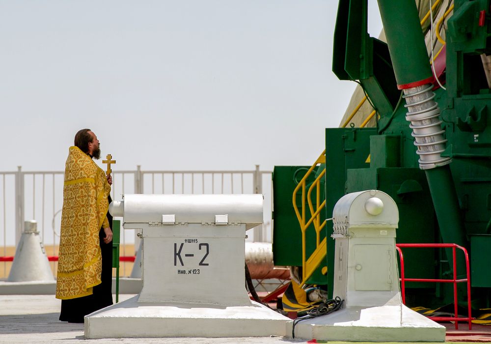 An Orthodox priest blesses the Soyuz rocket at the Baikonur Cosmodrome Launch pad on Friday, July 13, 2012 in Kazakhstan. The launch of the Soyuz spacecraft with Expedition 32 Soyuz Commander Yuri Malenchenko, NASA Flight Engineer Sunita Williams and JAXA (Japan Aerospace Exploration Agency) Flight Engineer Akihiko Hoshide is scheduled for the morning of Sunday, July 15, local time. (NASA/Carla Cioffi)
