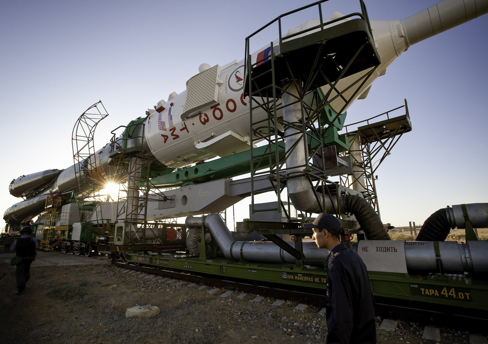 The Soyuz TMA-19 spacecraft is rolled out by train to the launch pad at the Baikonur Cosmodrome, Kazakhstan, Sunday, June 13, 2010. The launch of the Soyuz spacecraft with Expedition 24 NASA Flight Engineers Shannon Walker and Doug Wheelock, and Russian Soyuz Commander Fyodor Yurchikhin is scheduled for Wednesday, June 16, 2010 at 3:35 a.m. Kazakhstan time. (NASA/Carla Cioffi)