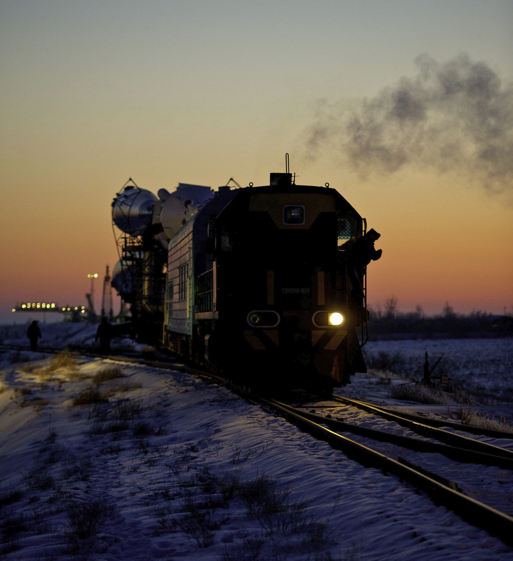 The Soyuz TMA-03M spacecraft is rolled out by train on its way to the launch pad at the Baikonur Cosmodrome, Kazakhstan, Monday, Dec. 19, 2011. The launch of the Soyuz spacecraft with Expedition 30 Soyuz Commander Oleg Kononenko of Russia, NASA Flight Engineer Don Pettit and ESA (European Space Agency) astronaut and Flight Engineer Andre Kuipers is scheduled for 7:16 p.m. local time on Wednesday, December 21. Photo Credit (NASA/Carla Cioffi)