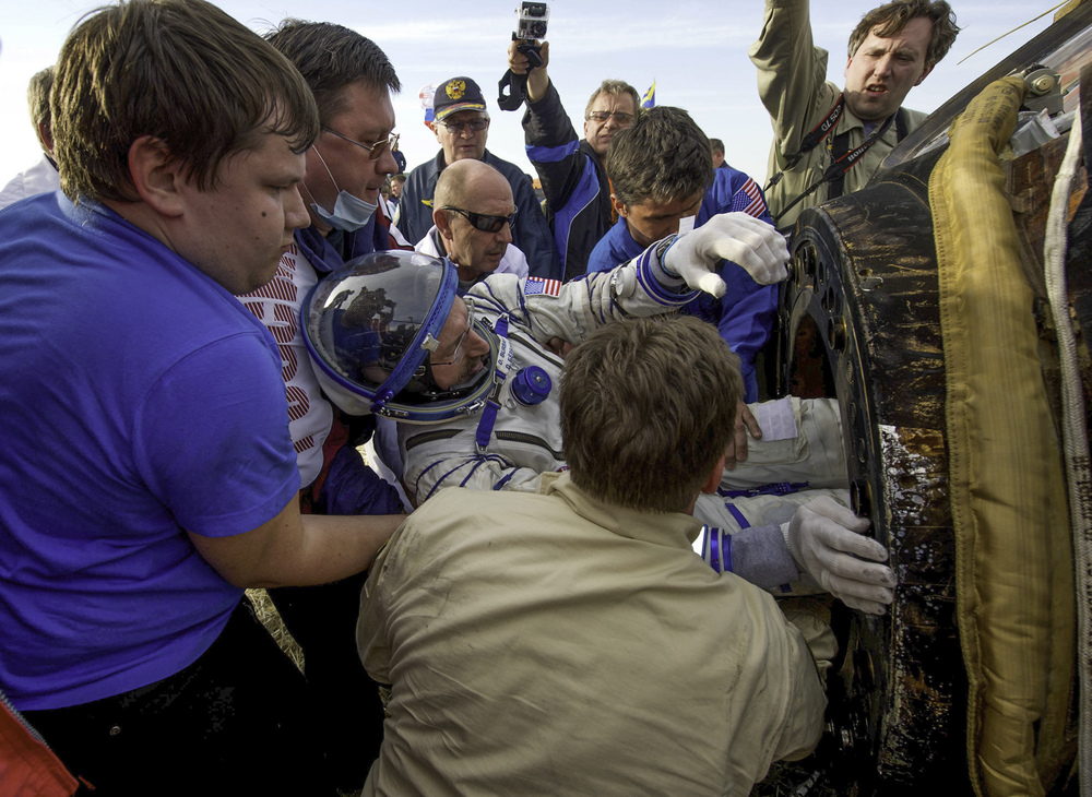 Expedition 30 Commander Dan Burbank is seen as he is extracted from the Soyuz TMA-22 spacecraft shortly after the capsule landed with Russian flight engineers Anton Shkaplerov and Anatoly Ivanishin in a remote area outside of the town of Arkalyk, Kazakhstan on Friday, April 27, 2012. Burbank, Ivanishin, and Shkaplerov are returning from more than five months onboard the International Space Station where they served as members of the Expedition 29 and 30 crews. (NASA/Carla Cioffi)