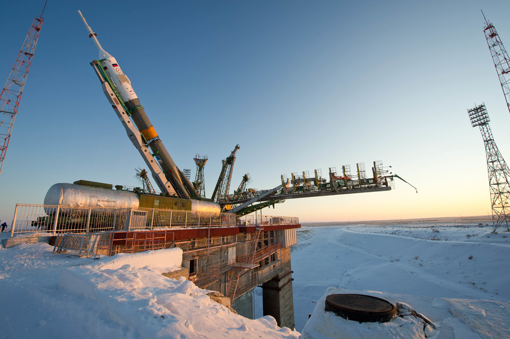 The Soyuz TMA-03M spacecraft is lifted on to the launch pad at the Baikonur Cosmodrome in Kazakhstan, Monday, Dec. 19, 2011. The rocket is being prepared for launch on December 21 to carry the crew of Expedition 30 to the International Space Station. (NASA/Carla Cioffi)