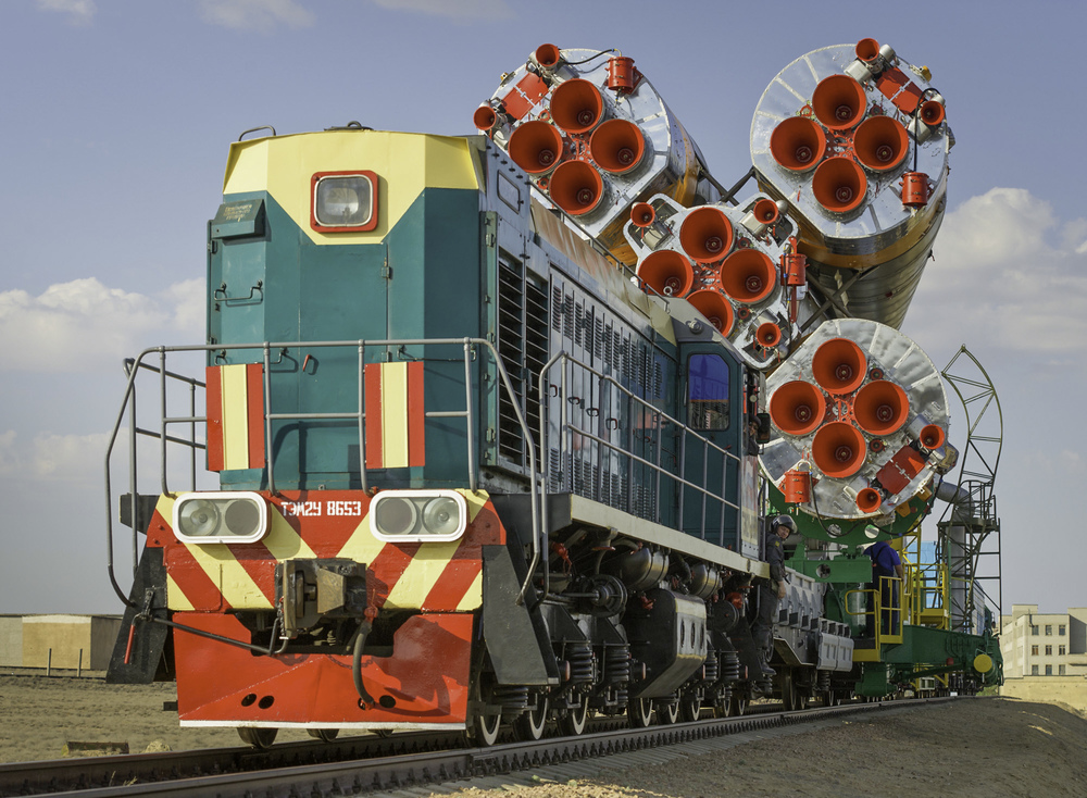 The Soyuz TMA-02M spacecraft is carried by train on its way to the launch pad at the Baikonur Cosmodrome, Kazakhstan, Sunday, June 5, 2011. The launch of the Soyuz spacecraft with Expedition 28 Soyuz Commander Sergei Volkov of Russia, NASA Flight Engineer Mike Fossum and JAXA (Japan Aerospace Exploration Agency) Flight Engineer Satoshi Furukawa is scheduled for 2:15 a.m. local time on Wednesday, June 8, 2011. (NASA/Carla Cioffi)