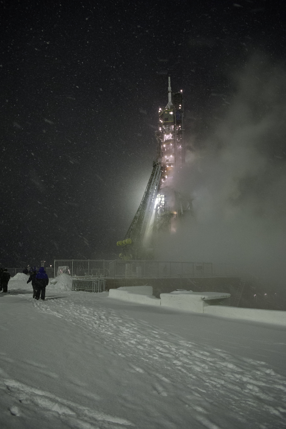 The Soyuz TMA-22 rocket is seen at the Soyuz launch pad during a snow storm the morning of the launch of Expedition 29 to the International Space Station at the Baikonur Cosmodrome in Kazakhstan, Monday, Nov. 14, 2011. (NASA/Carla Cioffi)