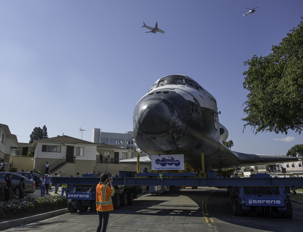Space shuttle Endeavour is seen on the streets of Inglewood, CA on Saturday, Oct. 13, 2012. Endeavour, built as a replacement for space shuttle Challenger, completed 25 missions, spent 299 days in orbit, and orbited Earth 4,671 times while traveling 122,883,151 miles. Beginning Oct. 30, the shuttle will be on display in the CSC's Samuel Oschin Space Shuttle Endeavour Display Pavilion, embarking on its new mission to commemorate past achievements in space and educate and inspire future generations of explorers. (NASA/Carla Cioffi)