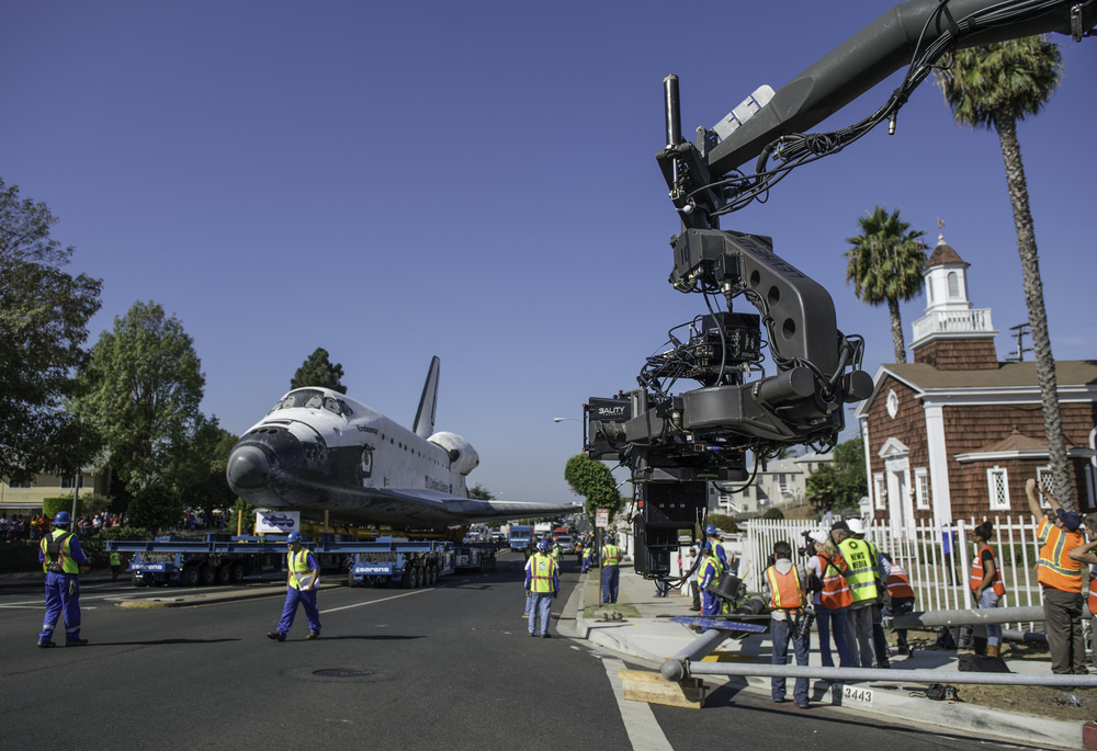 A 3D camera films the space shuttle Endeavour as it makes its way through the streets of Inglewood on its way to its new home at the California Science Center, Saturday, Oct. 13, 2012. Endeavour, built as a replacement for space shuttle Challenger, completed 25 missions, spent 299 days in orbit, and orbited Earth 4,671 times while traveling 122,883,151 miles. Beginning Oct. 30, the shuttle will be on display in the CSC's Samuel Oschin Space Shuttle Endeavour Display Pavilion, embarking on its new mission to commemorate past achievements in space and educate and inspire future generations of explorers. (NASA/Carla Cioffi)