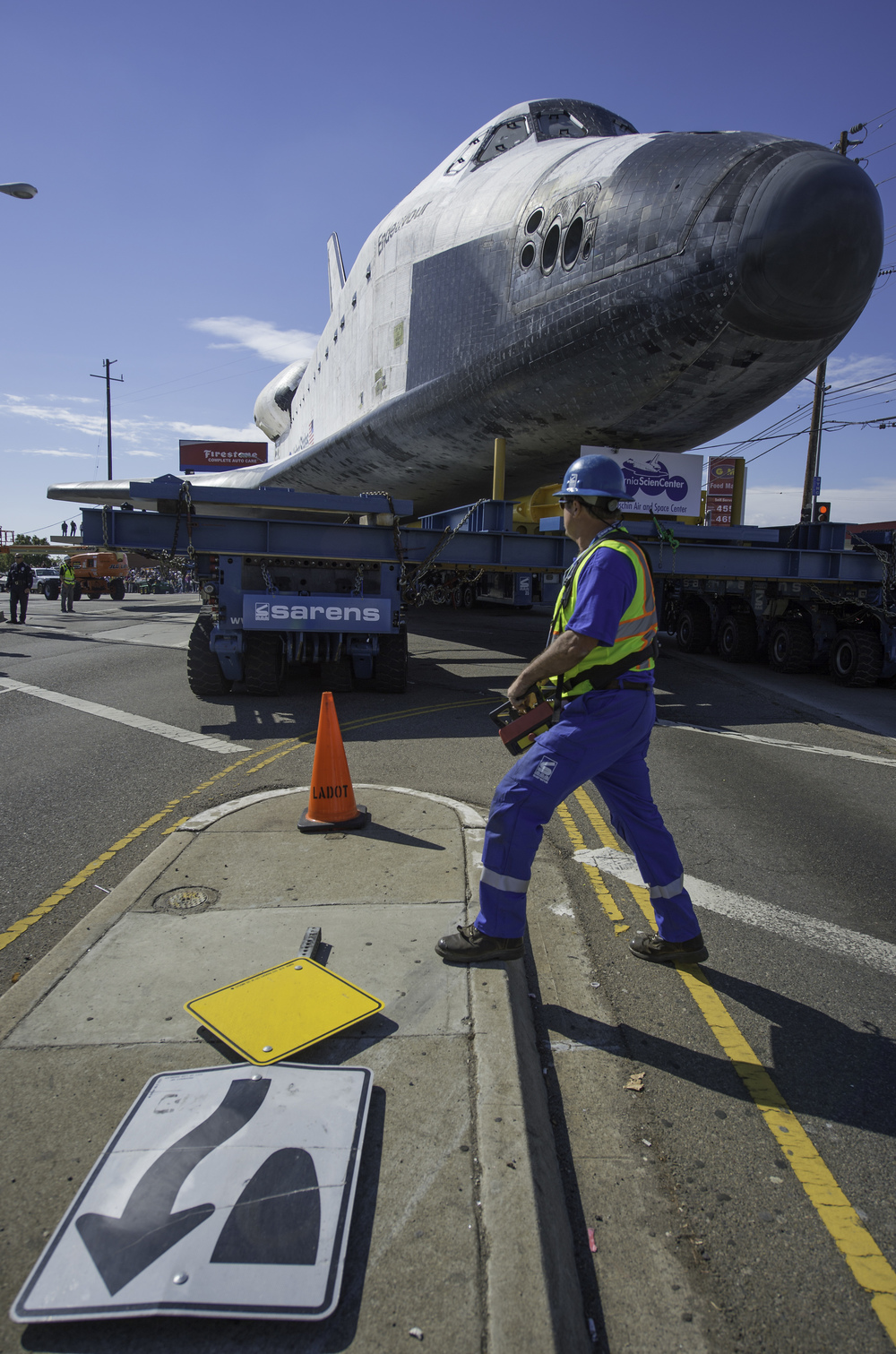 The driver of the Over Land Transporter (OLT) is seen as he maneuvers the space shuttle Endeavour on the streets of Los Angeles as it heads to its new home at the California Science Center, Friday, Oct. 12, 2012. Endeavour, built as a replacement for space shuttle Challenger, completed 25 missions, spent 299 days in orbit, and orbited Earth 4,671 times while traveling 122,883,151 miles. Beginning Oct. 30, the shuttle will be on display in the CSC's Samuel Oschin Space Shuttle Endeavour Display Pavilion, embarking on its new mission to commemorate past achievements in space and educate and inspire future generations of explorers. (NASA/Carla Cioffi)