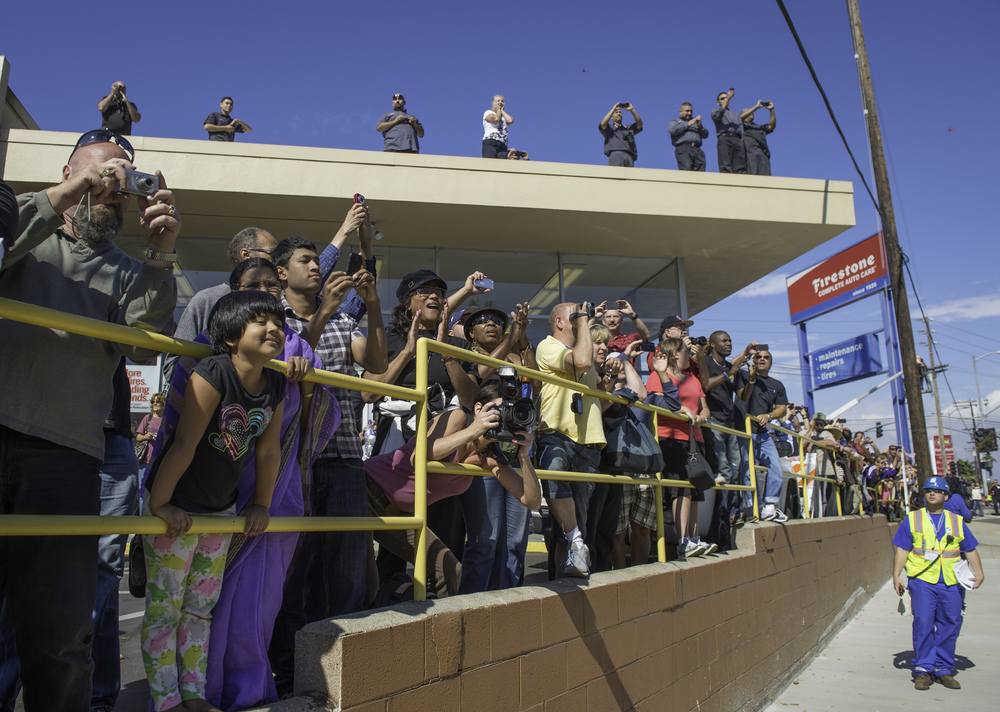 Spectators line up to watch space shuttle Endeavour as it passes by on its way to its new home at the California Science Center in Los Angeles, Friday, Oct. 12, 2012. Endeavour, built as a replacement for space shuttle Challenger, completed 25 missions, spent 299 days in orbit, and orbited Earth 4,671 times while traveling 122,883,151 miles. Beginning Oct. 30, the shuttle will be on display in the CSC's Samuel Oschin Space Shuttle Endeavour Display Pavilion, embarking on its new mission to commemorate past achievements in space and educate and inspire future generations of explorers. (NASA/Carla Cioffi)