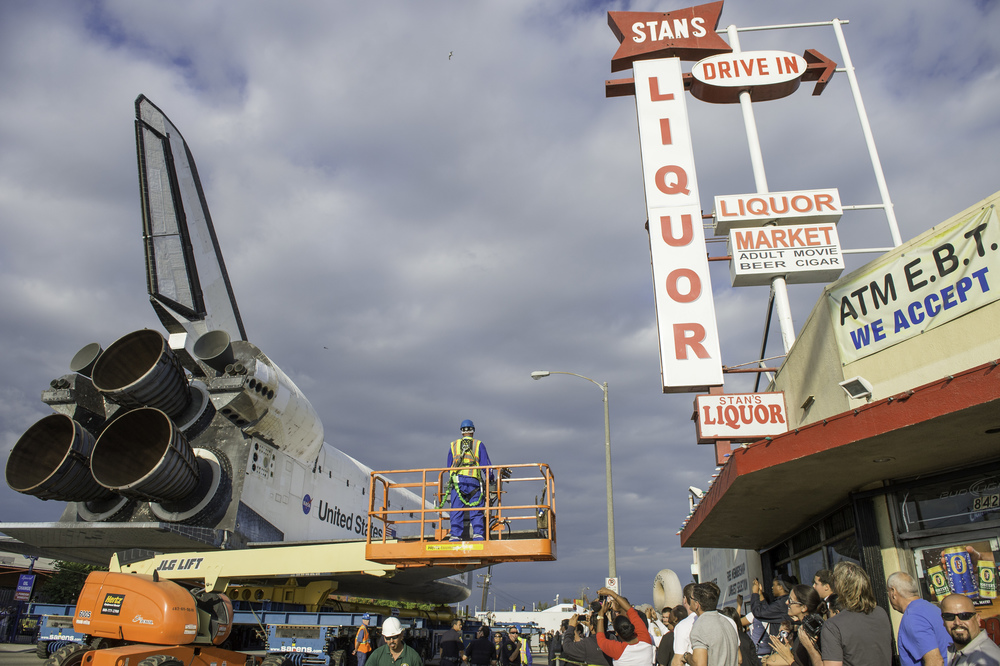 Space shuttle Endeavour is seen on its way to its new home at the California Science Center in Los Angeles, Friday, Oct. 12, 2012. Endeavour, built as a replacement for space shuttle Challenger, completed 25 missions, spent 299 days in orbit, and orbited Earth 4,671 times while traveling 122,883,151 miles. Beginning Oct. 30, the shuttle will be on display in the CSC's Samuel Oschin Space Shuttle Endeavour Display Pavilion, embarking on its new mission to commemorate past achievements in space and educate and inspire future generations of explorers. (NASA/Carla Cioffi)