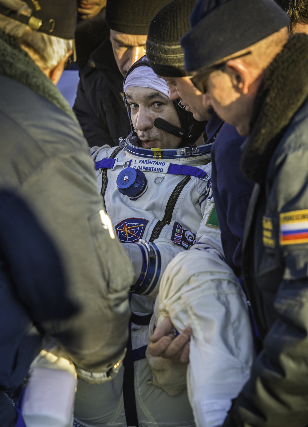 Expedition 37 Luca Parmitano of ESA (European Space Agency) is carried from the Soyuz TMA-09M spacecraft minutes after he landed in a remote area outside the town of Zhezkazgan, Kazakhstan, on Monday, Nov. 11, 2013. Parmitano, Expedition 37 Commander Fyodor Yurchikhin of the Russian Federal Space Agency (Roscosmos) and NASA Flight Engineer Karen Nyberg returned to earth after five and a half months on the International Space Station. (NASA/Carla Cioffi)