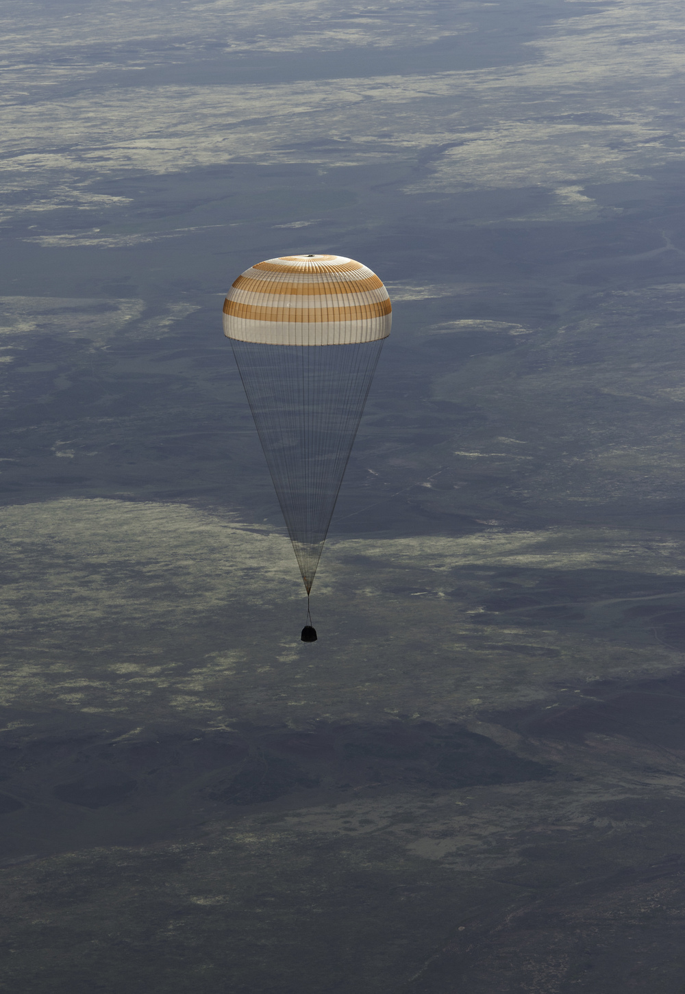 The Soyuz TMA-07M spacecraft is seen as it lands with Expedition 35 Commander Chris Hadfield of the Canadian Space Agency (CSA), NASA Flight Engineer Tom Marshburn and Russian Flight Engineer Roman Romanenko of the Russian Federal Space Agency (Roscosmos) in a remote area near the town of Zhezkazgan, Kazakhstan, on Tuesday, May 14, 2013. Hadfield, Marshburn and Romanenko returned from five months onboard the International Space Station where they served as members of the Expedition 34 and 35 crews. (NASA/Carla Cioffi)