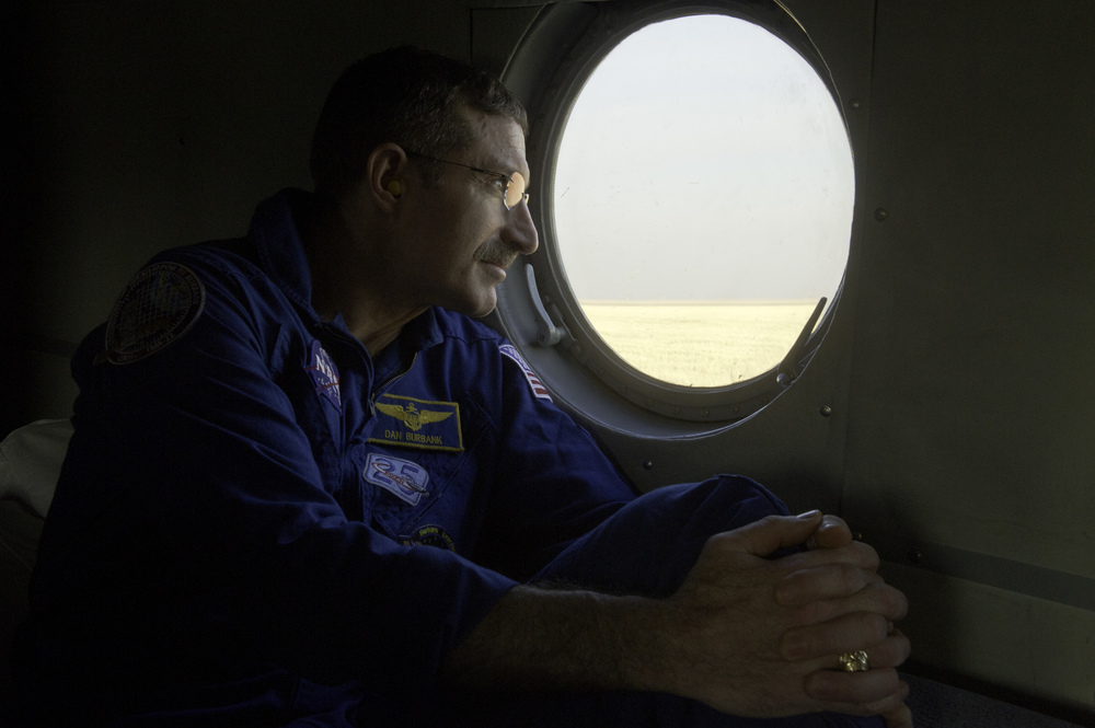 Expedition 30 Commander Dan Burbank looks out the window of his helicopter as it prepares to depart for Kustanai from the Soyuz TMA-22 capsule landing site outside of the town of Arkalyk, Kazakhstan on Friday, April 27, 2012. Astronaut Burbank, Russian Cosmonauts Shkaplerov and Ivanishin are returning from more than five months onboard the International Space Station where they served as members of the Expedition 29 and 30 crews. (NASA/Carla Cioffi)