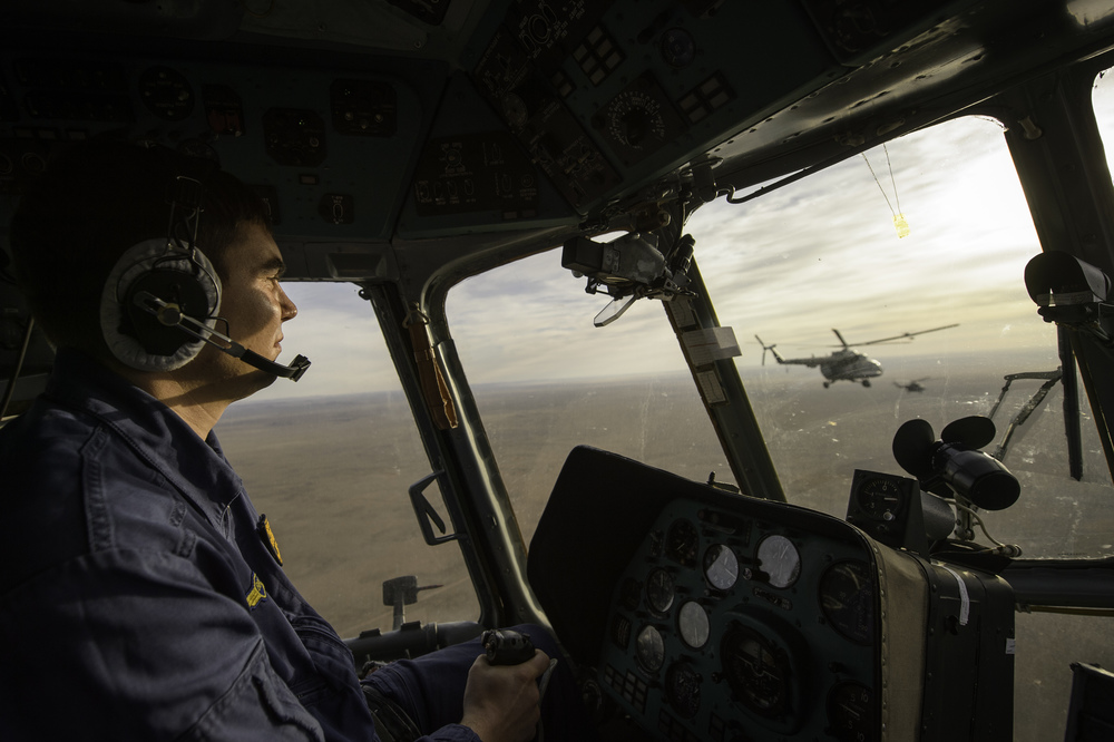 A Russian search and rescue helicopter co-pilot is seen in the cockpit of his helicopter en route to Zhezkazgan airport in Kazakhstan, Sunday, Nov. 10, 2013, a day ahead of the scheduled landing of the Soyuz TMA-09M spacecraft with Expedition 37 Commander Fyodor Yurchikhin of the Russian Federal Space Agency (Roscosmos), Flight Engineer Karen Nyberg of NASA and Flight Engineer Luca Parmitano of the European Space Agency. Yurchikhin, Nyberg and Parmitano are returning to Earth after five and a half months on the International Space Station. (NASA/Carla Cioffi)