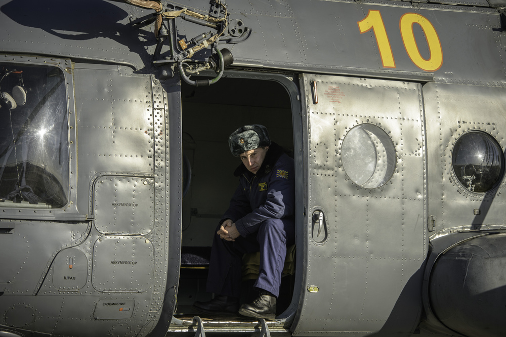 A member of Russian search and rescue is seen in his helicopter after landing at Zhezkazgan airport in Kazakhstan, Sunday, Nov. 10, 2013, a day ahead of the scheduled landing of the Soyuz TMA-09M spacecraft with Expedition 37 Commander Fyodor Yurchikhin of the Russian Federal Space Agency (Roscosmos), Flight Engineer Karen Nyberg of NASA and Flight Engineer Luca Parmitano of the European Space Agency. Yurchikhin, Nyberg and Parmitano are returning to Earth after five and a half months on the International Space Station. (NASA/Carla Cioffi)